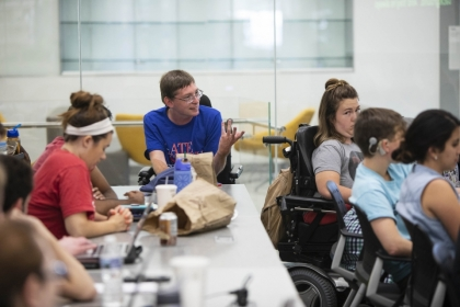 students, including some with disabilities, participate in a class discussion
